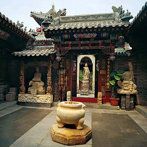 Monastery and the Chinese chameleon and invisible man Liu Bolin City Camouflage