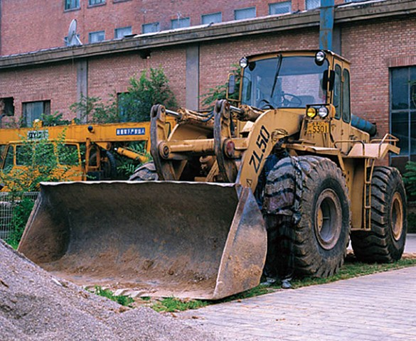 Bulldozer and the Chinese chameleon and invisible man Liu Bolin City Camouflage