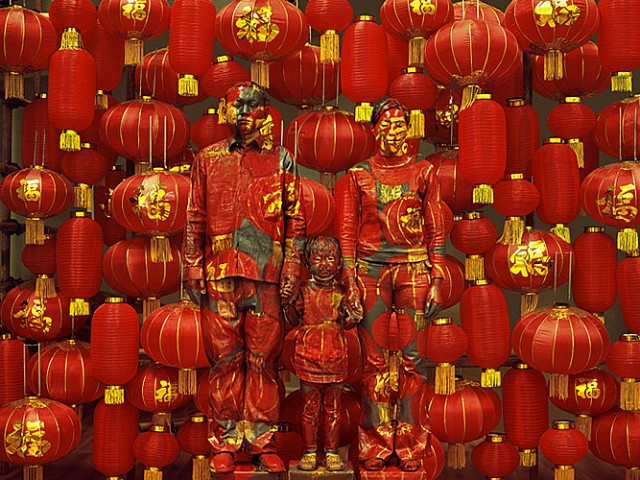 Family and the Chinese chameleon and invisible man Liu Bolin City Camouflage
