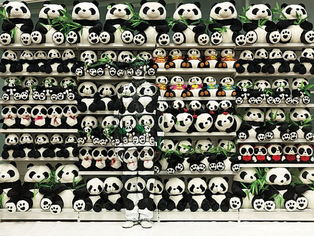 Panda and the Chinese chameleon and invisible man Liu Bolin City Camouflage