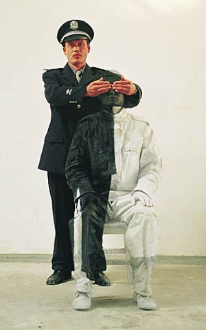 Policeman and the Chinese chameleon and invisible man Liu Bolin City Camouflage