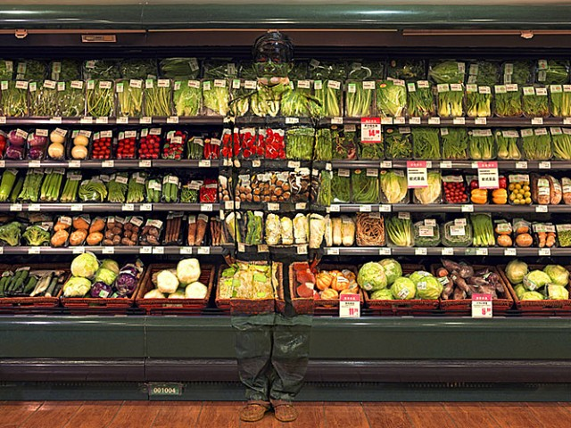 Vegetables and the Chinese chameleon and invisible man Liu Bolin City Camouflage